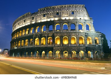 The world famous Colosseum in Rome illuminated at dusk with street