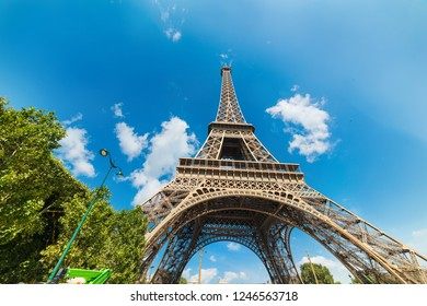World famous Eiffel tower under a blue sky with clouds. Paris, France