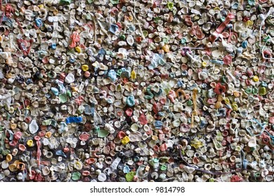 World famous gum wall in Post Alley Seattle Washington. A wall covered in chewing gum. Also makes a great abstract background