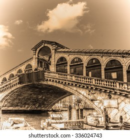 World famous Rialto bridge on a clear day in sepia tone, Italy