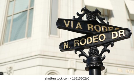 World famous Rodeo Drive symbol, Cross Street Sign, Intersection in Beverly Hills. Touristic Los Angeles, California, USA. Rich wealthy life consumerism, Luxury brands and high-class stores concept