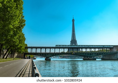 World Famous Structure Eiffel Tower and Bir-Hakeim Bridge with Subway Metro Train Passing Busy City and road traffic