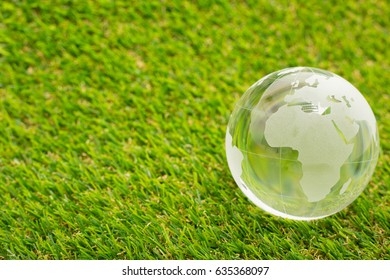 World glass with green grass for social network and business.