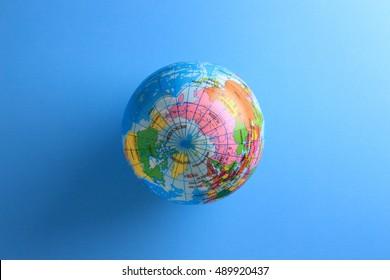 world globe ball on blue paper background