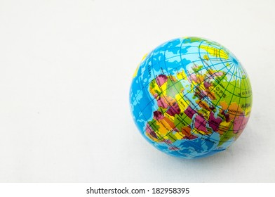 The World Globe Made of Rubber on a White Background
