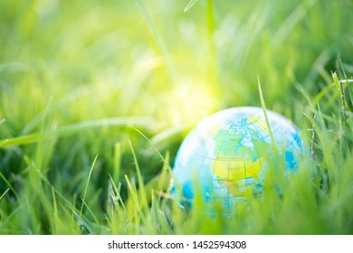World globe on grass field with copy space. Environment and Earth day concept.