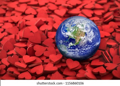 World globe on hundreds of small red hearts. Earth Day concept. Earth photo provided by Nasa.