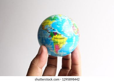 World globe  on a palm over a white. Globalization Concept