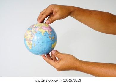 World globe on a palm over a white background. Globalization Concept