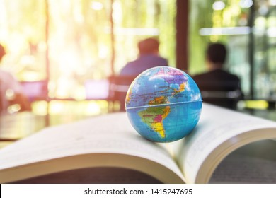 World globe on text book. Graduate study abroad programs. International education school Concept.