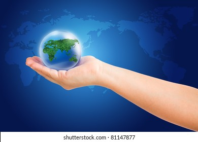 world in hand and global on blue map background. save path world and hand for isolated design work