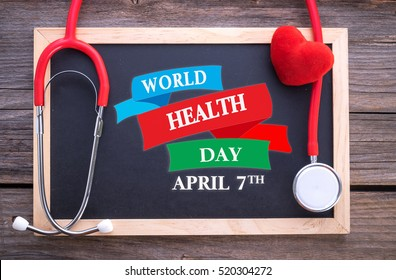 World Health Day, April 7th on chalkboard, stethoscope and red heart, health concepts.