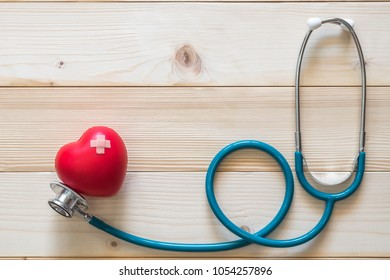 World health day campaign with red heart with cross bandage and medical doctor's stethoscope, Cholesterol test, high pressure blood control and first aid concept