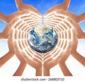 World health day concept: Earth globe in hands for heart shape over blue sky background. Elements of this image furnished by NASA