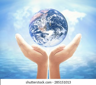 World health day concept: Earth globe in hands. Elements of this image furnished by NASA