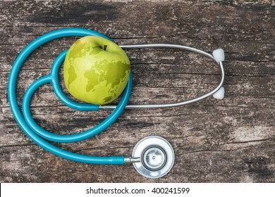 World health day and National Food Safety Education Month symbolic concept with map on healthy nutritional apple antioxidant fruit with doctor's stethoscope