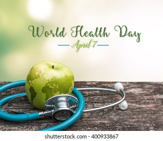 World health day symbolic concept with map on healthy antioxidant fruit nutritional apple with medical doctor's stethoscope