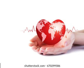 World heart day concept of young woman hand holding red heart with world map on white background
