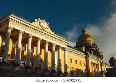 World heritage concept. Beautiful view at facade of modern hotel and Saint Isaac's Cathedral in Saint Petersburg. Sunny cloudy weather. Text space. Outdoor shot