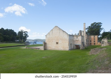 World Heritage Site of  Port Arthur Convict Museum Settlement in Tasmania, Australia, with ruins of historic prison and other buildings and harbour in background - Shutterstock ID 254519959
