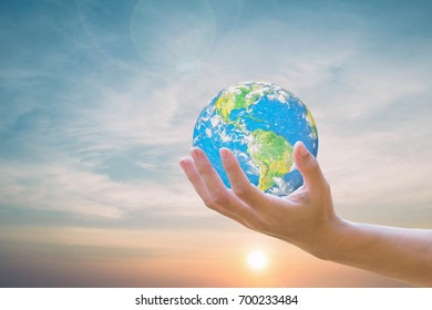 World Human hands the sky in the background blurred.Environment Day Ecology concept. .Elements of this image furnished by NASA.