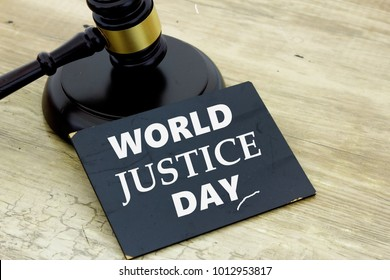 WORLD JUSTICE DAY words with gavel and block on wooden table