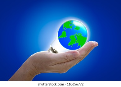 the world in light bulb on the hand