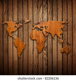 world map carving on wood plank