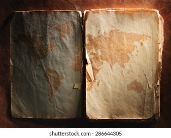 world map displayed on the spread of vintage books. Close up