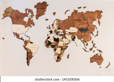 World map of earth showing continents on a wood tree ring textured background on white