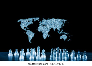 the world map and a game of chess symbolize the struggle for power