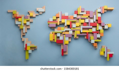 World map made from wooden toy blocks. Top view on world global map made of colourful wooden toy bricks. World unity, diversity and education concept.