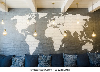 World map on brick wall with light bulb, modern decoration or interior design