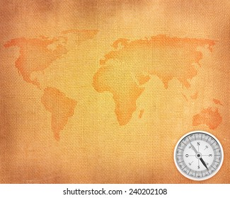 World map on a linen background and compass