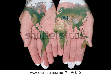 World Map Painted On Hands Showing Concept Of The World In Our Hands