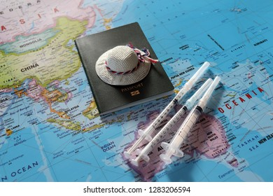 World map and passport. Pre trip vaccination concept.