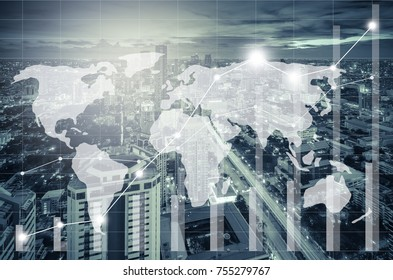 world map and trading graph on the cityscape at night as background,Business financial concept, blue tone process