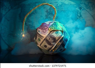 The world of money is burning.Financial bomb explodes.Smoke,fuse.Dollar and Euro decrease. Global economic recession concept.World map in the background.Financial crisis