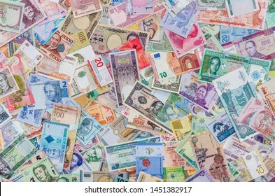 World money collection of different countries as background