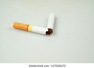 World No Tobacco Day : Broken cigarette isolated on white background