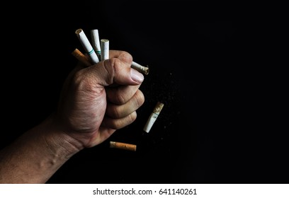 world no tobacco day concept. cigarettes in the hands of men  with soft-focus in the background. over light