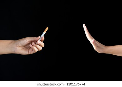 World No Tobacco Day, May 31. Just say NO to STOP Smoking. Close up Man hand Reject cigarette offer on black background.