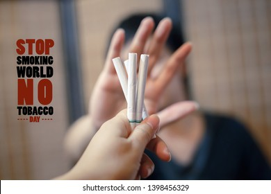 World No Tobacco Day, May 31. Human hand giving cigarette and a man hand Reject cigarette offer on blur background. Quit smoking for life on World no Tobacco day concept. Just say NO to STOP Smoking.