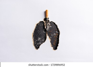 World No Tobacco Day, May 31. Cigarette burning the lungs paper on black background. World No Tobacco Day. Stop smoking concept.