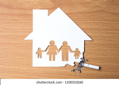 world no tobacco day.Cut the paper of family members in home, destroyed by cigarettes.