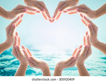 World ocean day and saving water for csr campaign concept with collaborative hands in love heart shape