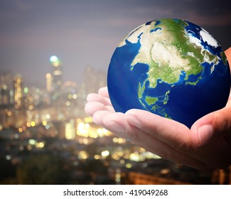 The world is on hold for the city bokeh blur background. Elements of this image furnished by NASA.