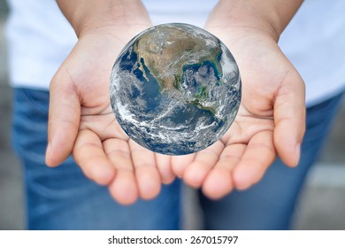World on the palm. Elements of this image furnished by NASA