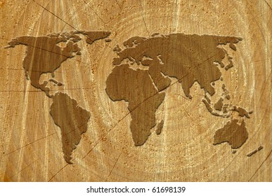 World outline map on surface of sawn tree