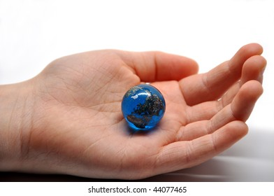 the world in the palm of a childs hand